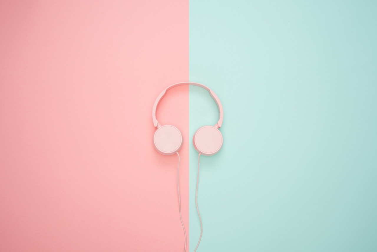 Headphone on pink and green background